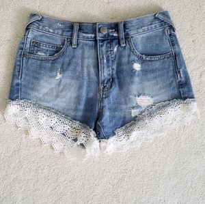 Free People Lace trimmed distressed jean shorts 24